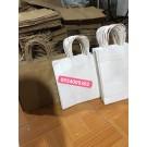 Túi giấy quai giấy kraft trắng giá rẻ